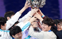 DWG KIA lift up the Summoners Cup at Worlds 2020 (Courtesy of Riot Games)